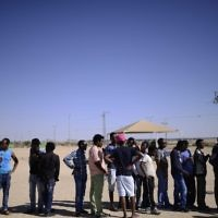 African asylum seekers gather at the entrance to Holot Detention Center in southern Israel to mark the International Refugees Day on Saturday, June 18, 2016. (Tomer Neuberg/Flash90)