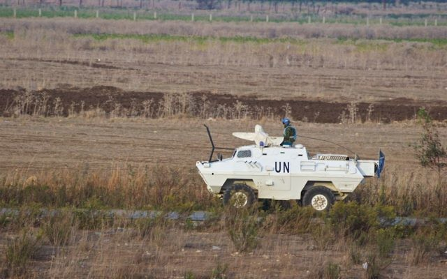 UN soldiers patrol on the Lebanese side of the border with Israel near Metula, in northern Israel, November 10, 2016. (Doron Horowitz/Flash90)