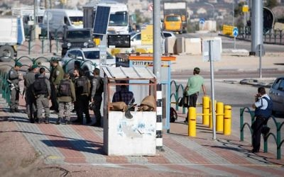 Illustrative: Israeli soldiers secure the scene after a Palestinian assailant attempting to stab Israeli guards at a junction near the West Bank city of Nablus, was shot and killed by Israeli soldiers on December 8, 2016.(Nasser Ishtayeh/Flash90)