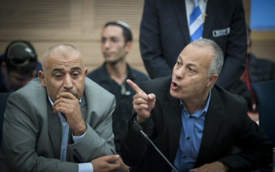 Joint (Arab) List MK Abdullah Abu Maaruf (R) attends a Status of Women and Gender Equality Committee meeting in the Knesset on December 13, 2016. (Yonatan Sindel/Flash90)