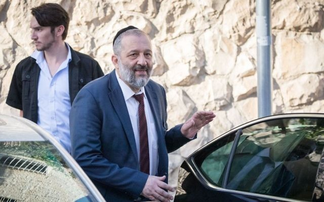 Aryeh Deri seen leaving his home in Jerusalem on the way to questioning at the Lahav 433 anti-corruption unit, June 5, 2017. (Yonatan Sindel/Flash90)