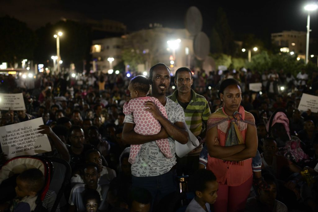 African migrants take part in a protest in Tel Aviv