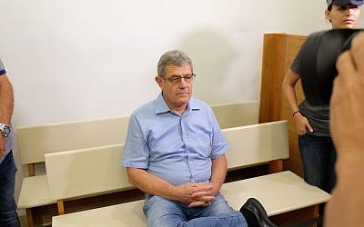 Miki Ganor, arrested in the submarine affair known as case 3000, is brought for a court hearing at the Magistrate's Court in Rishon Lezion, July 21, 2017. (FLASH90)