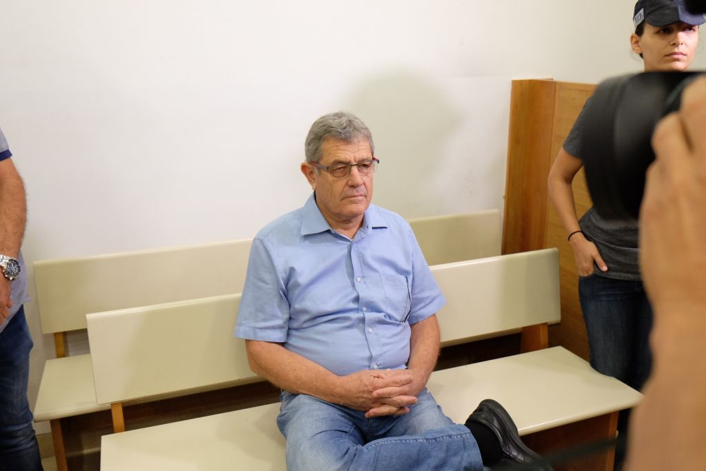 """Miki Ganor, arrested in the submarine affair known as """"case 3000"""", is brought for a court hearing at the Magistrate's Court in Rishon Lezion, July 21, 2017. (FLASH90)"""