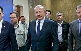 Prime Minister Benjamin Netanyahu arrives to the weekly cabinet meeting at Prime Minister's Office in Jerusalem on July 30, 2017. (Ohad Zweigenberg/POOL)