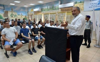 Israeli Defense Minister Avigdor Liberman speaks with new recruits to the Artillery Corps brigade at Tel ha Shomer IDF army base near Tel Aviv on July 31, 2017. (Ariel Hermoni/Ministry of Defense)