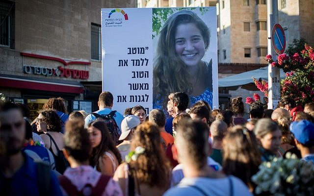 Participants in Jerusalem's annual Gay Pride Parade hold up a picture of 15-year-old Shira Banki on August 3, 2017. (Yonatan Sindel/Flash90)