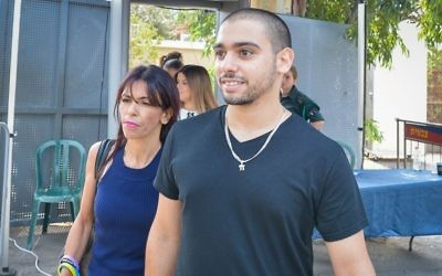 Former IDF soldier Elor Azaria arrives to the courtroom at the Kirya military base in Tel Aviv on August 8, 2017. (Roy Alima/Flash90)