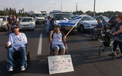 Illustrative: Disabled protesters demonstrate on a main road outside Kibbutz Yakum in central Israel on  August 14, 2017. (Flash90)