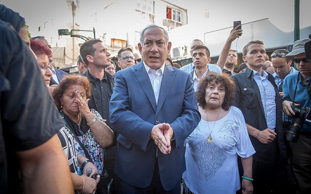 Prime Minister Benjamin Netanyahu meets with residents of south Tel Aviv during a tour in the neighborhood, August 31, 2017. (Miriam Alster/Flash90)