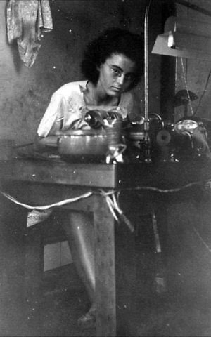 Marion Finkels Kreith, then 15 years old, works at a Cuban diamond-polishing factory. (Judith Kreith)