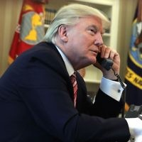 US President Donald Trump speaking on the phone in the Oval Office on June 27, 2017. (Alex Wong/Getty Images)