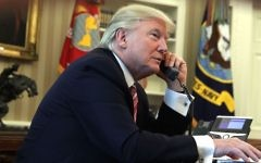 US President Donald Trump speaking on the phone in the Oval Office of the White House, June 27, 2017. (Alex Wong/Getty Images)