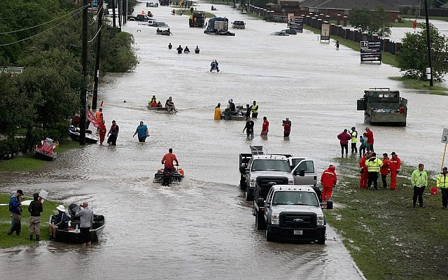 Houston residents and rescuers make their way out of a flooded neighborhood after it was inundated with rain following Hurricane Harvey, August 29, 2017. (Scott Olson/Getty Images)