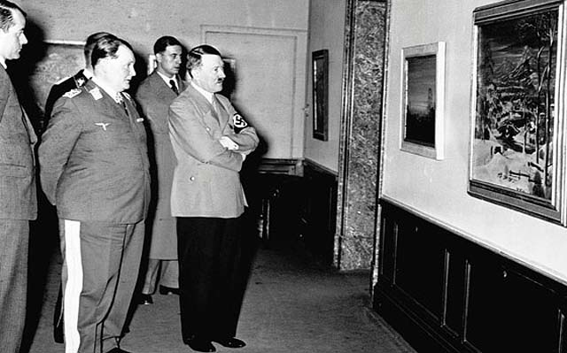 During the 1930s in Germany, Hermann Goering and Adolph Hitler examine a painting at an exhibit put on about degenerate art (Public domain)