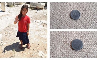 8-year-old Hallel Halevy holding her find of a rare 2,00-year-old half-shekel coin on August 23, 2017 in Halamish. (courtesy)