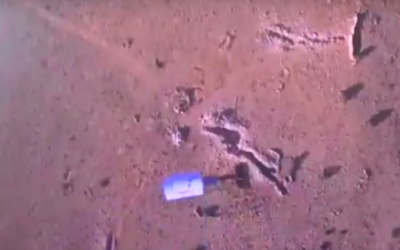 Footage from a video said to show bombs being dropped along the Lebanon-Syrian border by an attack drone belonging to the Hezbollah terror group. (Screen capture: YouTube)