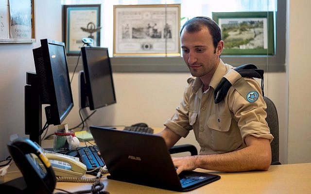 Sergeant Ilan Regenbaum of the Israeli Air Force Innovation Unit at his desk (IDF Spokesperson Unit)