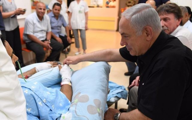 Prime Minister Benjamin Netanyahu visits Yavneh stabbing victim Niv Nehemiah in Kaplan Medical Center, August 8, 2017. (Kobi Gideon/GPO)