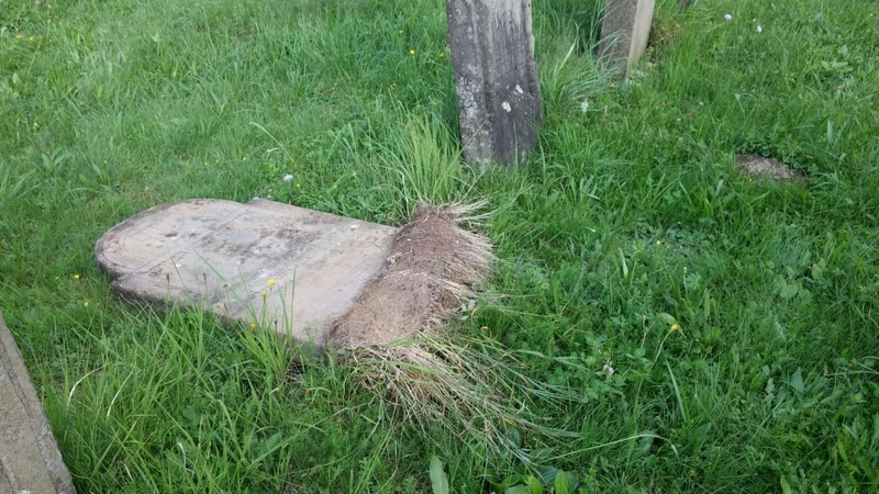 One of the some 20 headstones recently overturned and smashed the Jewish cemetery of Svaliava, Ukraine. (Chabad.org)