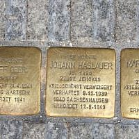 Illustrative: Three Stolpersteine, or 'stumbling stones,' dedicated to the memory of Josef Geer and to the Hauslauers -- a married couple who were Jehovah's Witnesses -- in Salzburg, Austria. (Noah Lederman/Times of Israel)