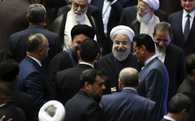 Iran's President Hasan Rouhani, center, leaves the parliament at the end of his swearing-in ceremony for the second term in office, in Tehran, Iran, Saturday, Aug. 5, 2017. (AP Photo/Ebrahim Noroozi)