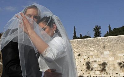 Bride and groom take wedding pictures at the Western Wall in Judaism's Old City. April 13, 2011. (Nati Shohat/Flash90)