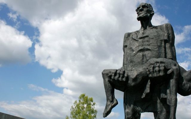 'The Unbowed Man' statue at the Khatyn Memorial in Belarus commemoratesYuzif Kaminsky, a survivor of Nazi atrocities, and his slain son Adam. (John Oldale/Wikimedia Commons/via JTA)