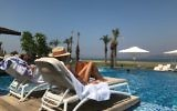 A woman sunbathing at the Setai hotel on the shore of the Sea of Galilee in Israel, August 25, 2017. (Andrew Tobin)