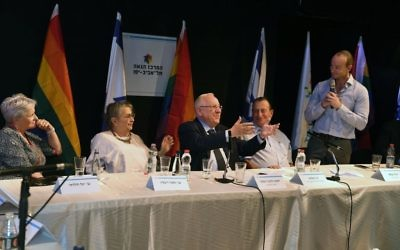 President Reuven Rivlin, center, attends an event to mark the eighth anniversary since a deadly shooting at a gay community center in Tel Aviv, August 10, 2017. (GPO/Mark Neiman)