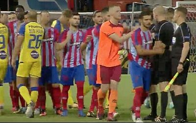 Players from Israel's Maccabi Tel Aviv soccer team great their counterparts from Greece's Panionios ahead of their soccer match in Greece on August 3, 2017. (Screen capture: YouTube)