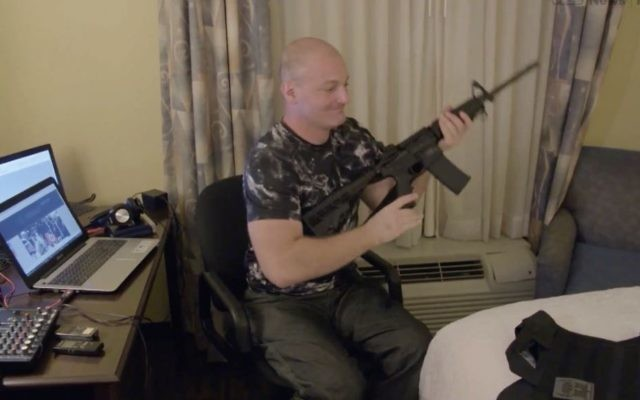 Christopher Cantwell, speaker for Unite the Right, shows off his weapons in this screenshot from Vice documentary 'Charlottesville: Race and Terror,' screened August 14, 2017. (Screenshot)