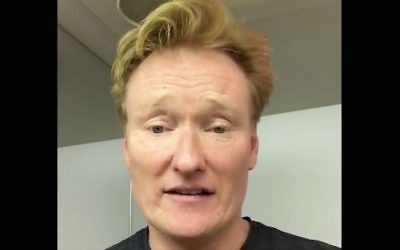 Conan O'Brien practices his Hebrew in an El Al airplane bathroom en route to Israel on August 25, 2016. (Screen capture: Twitter)