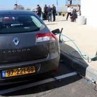 An electric Renault vehicle charges in Ramat Hasharon, Israel. February, 7 2010. (Roni Schutzer/Flash90/Maariv Out)