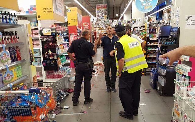 Police and medics respond to a stabbing in a supermarket in the central Israeli city of Yavneh on August 2, 2017. (United Hatzalah)