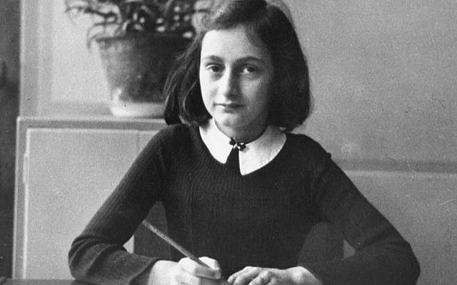 Anne Frank, aged 12, at her school desk in Amsterdam, 1941. (Courtesy, Beyond the Story)