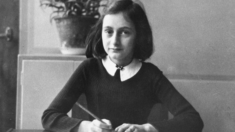 Anne Frank, at age 12, at her school desk in Amsterdam, 1941. (Photo credit: Courtesy Beyond the Story)