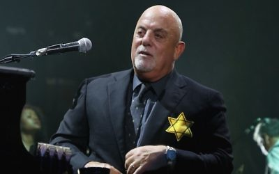 Billy Joel wears a jacket with the Star of David during the encore of his 43rd sold out show at Madison Square Garden on August 21, 2017, in New York City. (Myrna M. Suarez/Getty Images via JTA)