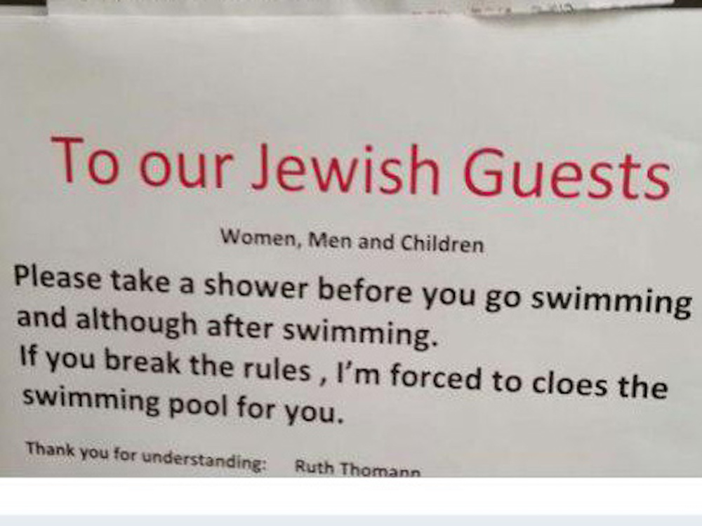 A sign put up at a Swiss hotel calling on Jewish guests to shower before going swimming (Courtesy)