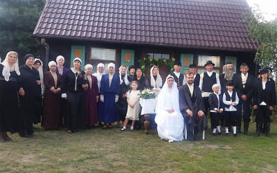 Villagers attending a fake Jewish wedding in the Polish village of Radzanow, August 5, 2017. (Jonny Daniels/From the Depths/via JTA)