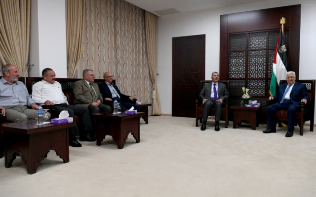Palestinian Authority President Mahmoud Abbas on August 1, 2017 holds a rare meeting in Ramallah with a  Hamas delegation, which included former Palestinian education minister Nasser al-Din al-Shaer, and  Hamas lawmakers, Mahmoud Al-Ramahi, Mohammad Totah, Ayman Daraghmeh and Samir Abu Eisha (Wafa/ Osama Falah)
