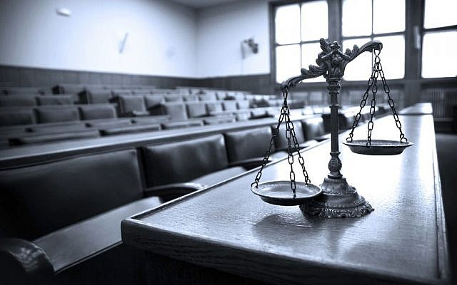 Illustrative image of Scales of Justice in a Courtroom. (tomloel/iStock via Getty images)