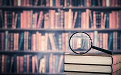 Illustrative: Books and a magnifying glass. (bee32/ iStock via Getty images)
