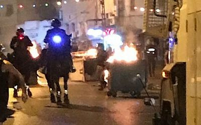 Police confront rioters in Jaffa on August 3, 2017. (Israel Police)