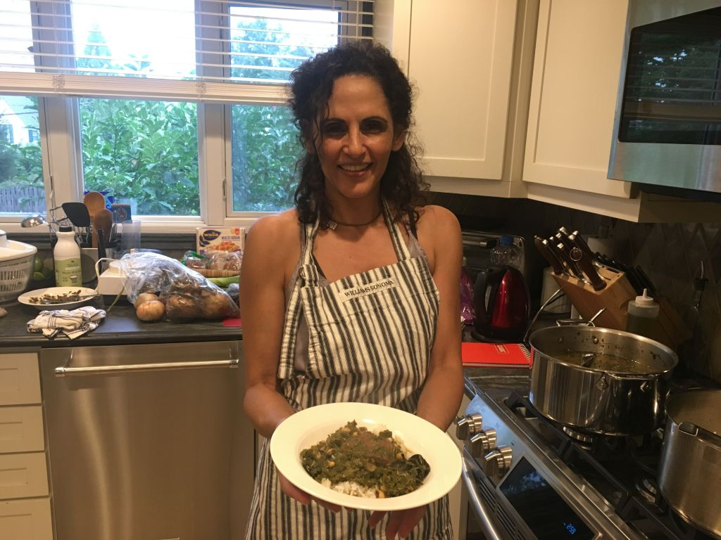 Ayala Hodak showing Ghormeh Sabzi, a Persian dish she cooked with the Jewish Food Society, at her home in Tenafly, NJ, August 15, 2017. (Josefin Dolsten/JTA)