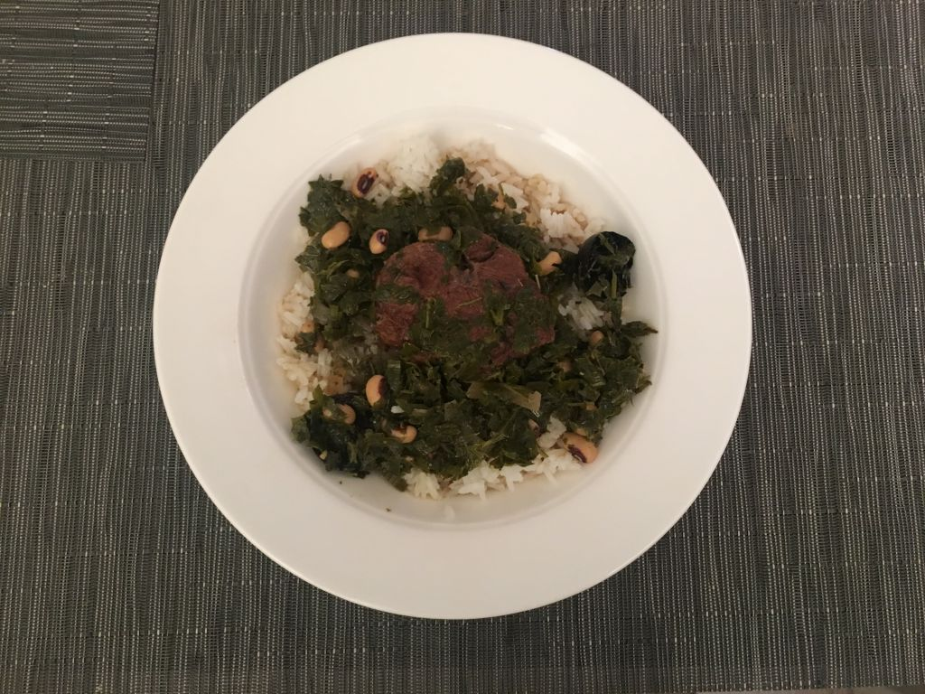 Ayala Hodak's Ghormeh Sabzi, a beef stew with herbs and served with rice. (Josefin Dolsten/JTA)