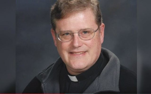 An undated photo provided by the Catholic Diocese of Arlington, Virginia, of Father William Aitcheson, a priest in the Roman Catholic Diocese of Arlington.  (screen capture)