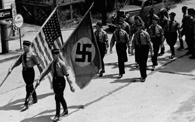 During the 1930s in Yaphank, New York, members of the Nazi party march through the Long Island town, where they also organized a pro-Hitler summer camp (Public domain)