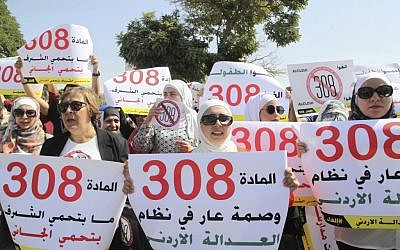 Women activists in front of Jordan's parliament in Amman call on legislators to repeal a provision that allows a rapist to escape punishment if he marries his victim. (AP Photo/Reem Saad)