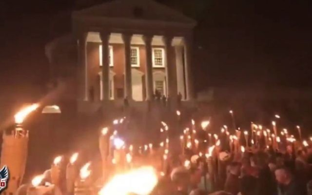 Torch-wielding white supremacists march at the University of Virginia on August 11, 2017 (Screen Capture/ YouTube)